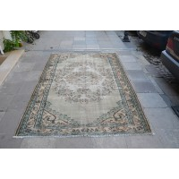 Green and Beige Faded Rug
